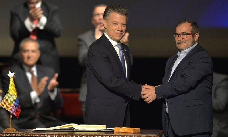 ▲哥倫比亞政府與人民軍FARC正式簽署和平協定,為停戰帶來新的曙光。(圖/取自衛報)