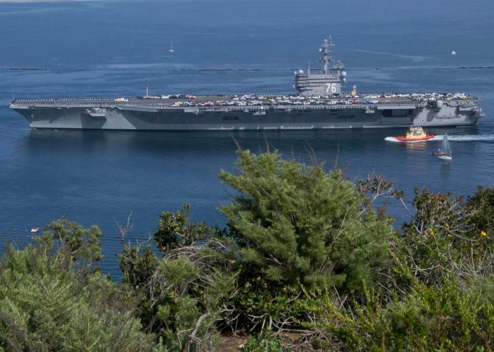 斷交後層級最高官員訪台 雷根號航艦巡弋東海防中國蠢動