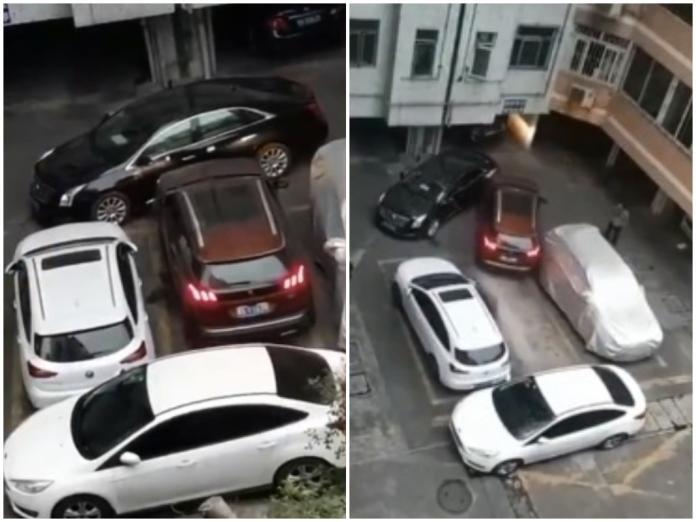 ▲被堵住的車主連撞了停在車頭的黑色凱迪拉克三次,才撞出一條路。(圖 / 翻攝自梨視頻)
