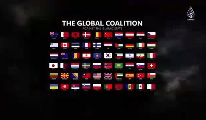 ▲由於台灣加入美國反恐聯盟,雖然未出兵作戰,但是也被伊斯蘭國網站列為恐攻報復對象,在伊斯蘭國網站上影片曾出現我國國旗。(圖/翻攝自ISIS宣傳影片)