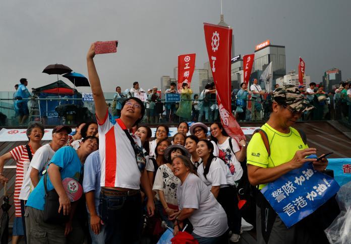 ▲中國大陸官媒力挺香港建制派20日發起的「守護香港」大遊行。(圖/美聯社/達志影像)