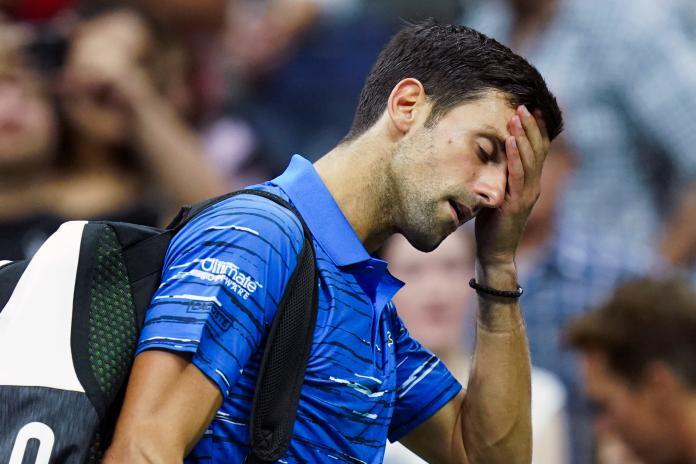 ▲塞爾維亞球王Novak Djokovic因傷退賽(圖/美聯社/達志影像)