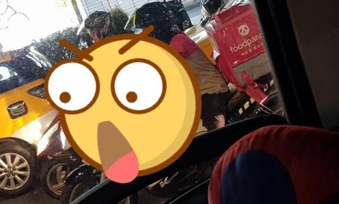▲一名網友日前在臉書上貼出一張從車內拍出的照片,她看見一名 foodpanda 外送員騎著高價的「 BMW K1200R 」在工作。(圖/翻攝爆廢公社二館)