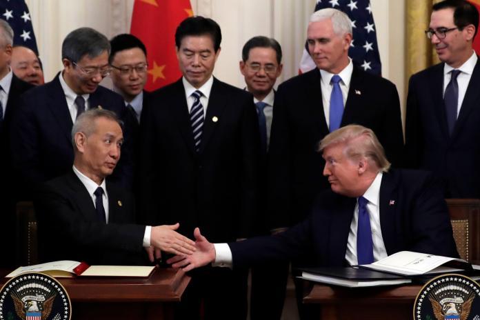 ▲美中簽署首階段貿易協議,開打一年半的貿易戰暫告緩和。(圖/美聯社/達志影像)