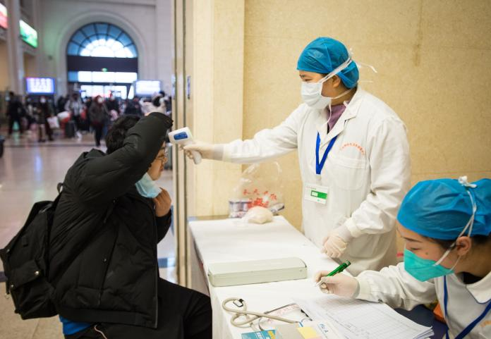 <br> ▲武漢火車站的檢疫工作。(圖/翻攝自新華社)