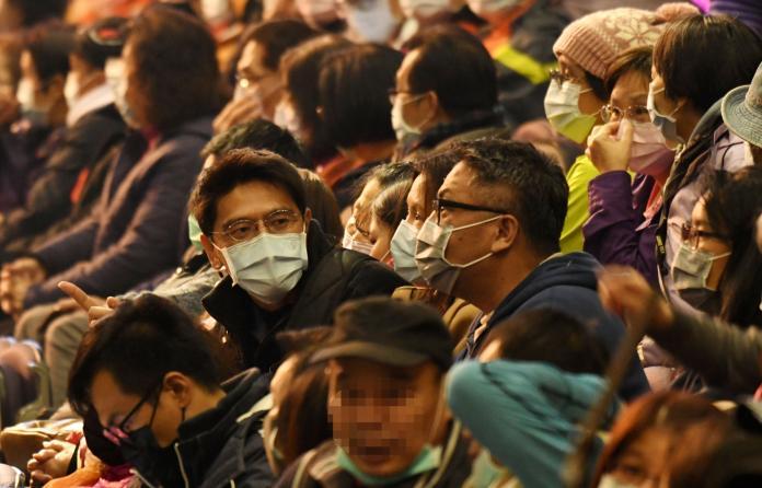 ▲武漢肺炎蔓延,路上不少人都有戴口罩。(圖/NOWnews資料畫面)