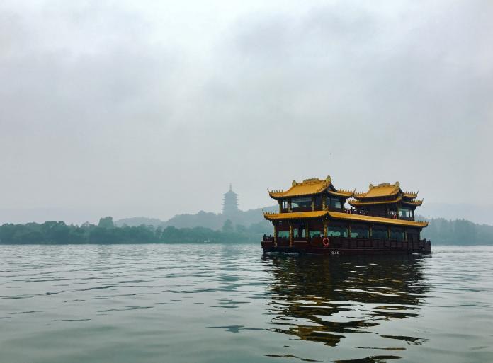 ▲中國多地景區陸續恢復開放。圖為杭州西湖。(圖/Unsplash)