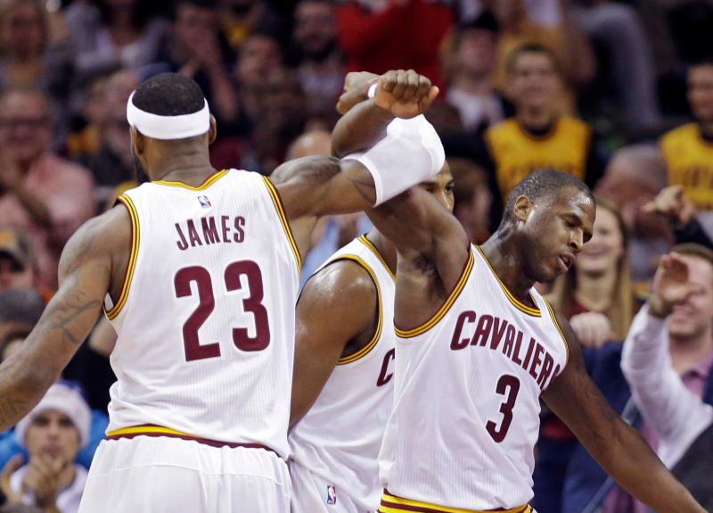 Cleveland Cavaliers' LeBron James (23) celebrates with Dion Waiters (3) in the fourth quarter of an NBA basketball game Sunday, Dec. 21, 2014, in Cleveland. The Cavaliers won 105-91. (AP Photo/Mark Duncan)