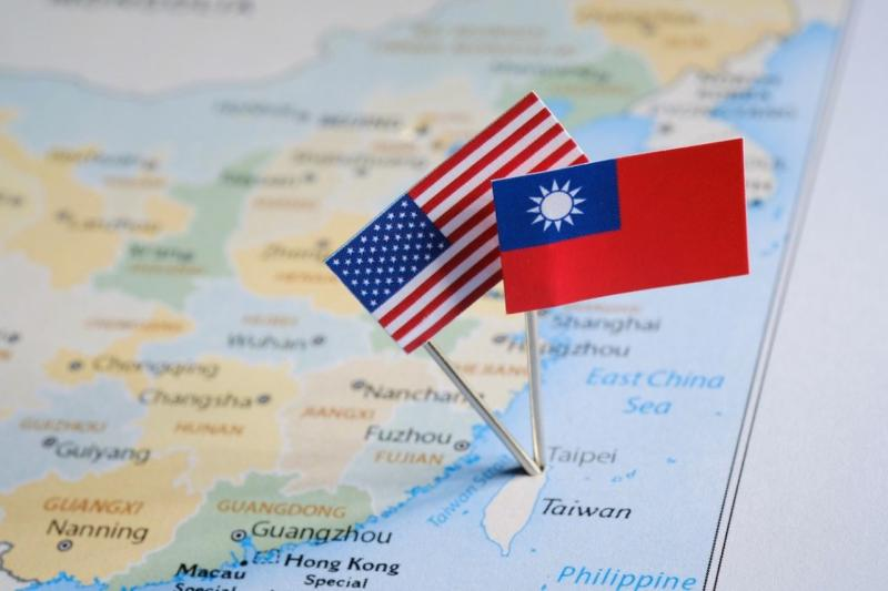 Taiwanese and American flags pinned on the map