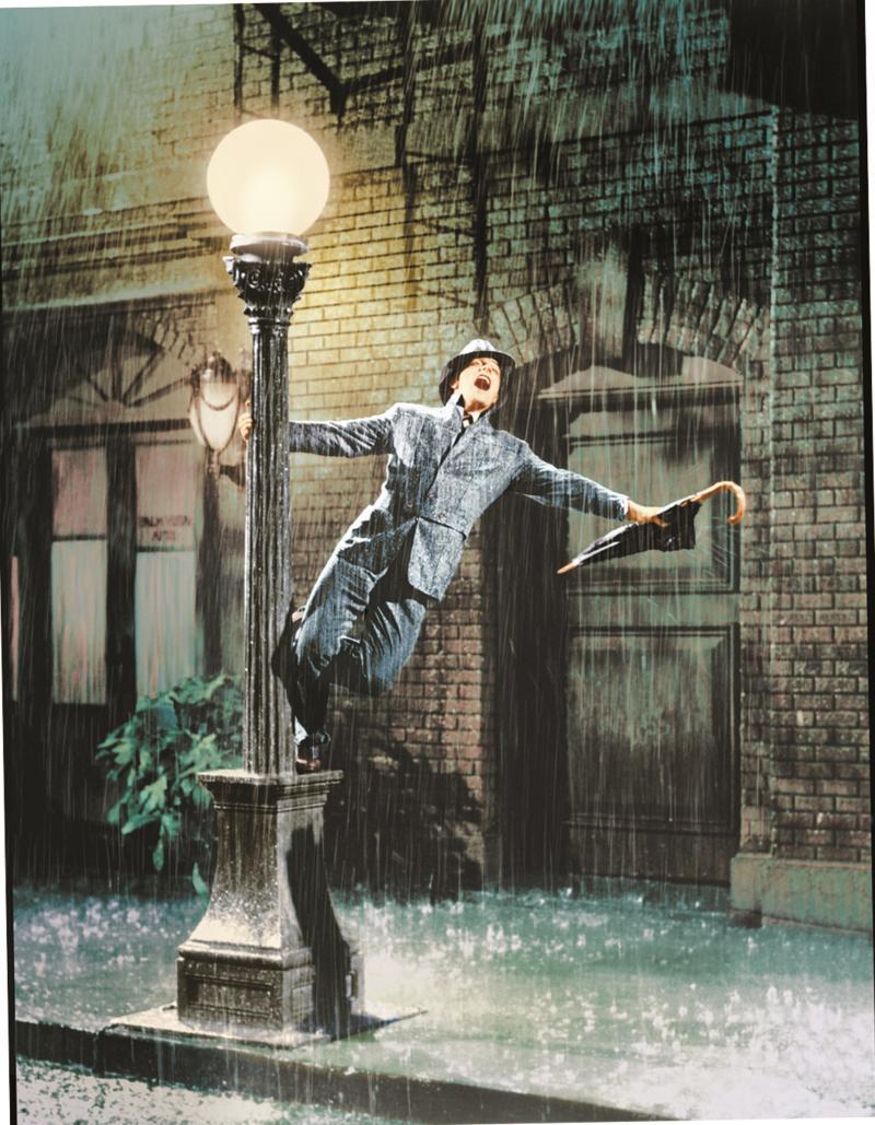 ▲金凱利在雨中即興歌舞,成為好萊塢電影史上難忘的經典片段。(圖/華納兄弟)