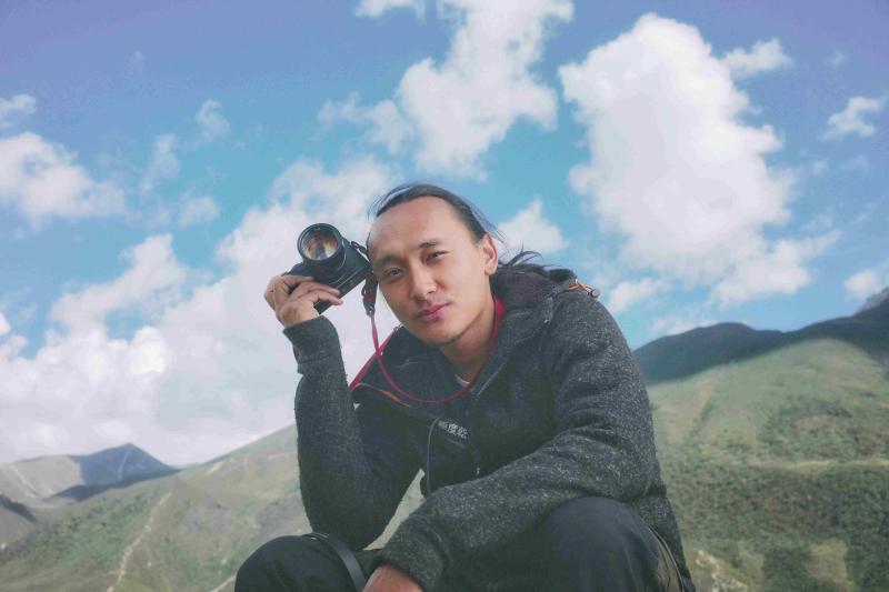 ▲Pawo是不丹的知名攝影師、編劇及導演。出身貴族的他,父親曾是不丹駐科威特外交官。(圖/海鵬)