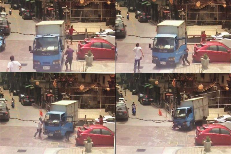 ▲貨車停車未拉手煞車「倒退嚕」,差一點撞上路過行人。(圖/讀者提供)