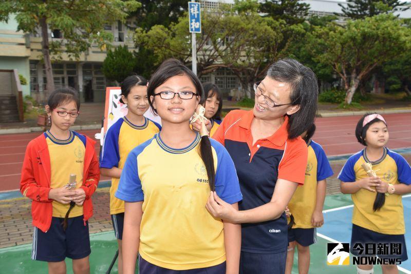 ▲發起人李湘妍同學表示,捐了頭髮心裡雖然很不捨,但是完成自己的心願就很開心。(圖/記者陳雅芳攝,2020.09.28)