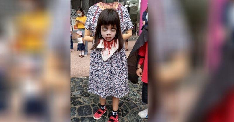網友「小桃爸」分享女兒小桃的「斷頭鬼」裝扮,逼真造型在網路上掀起討論