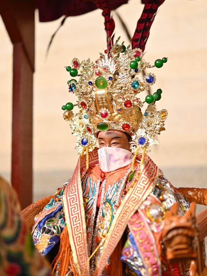 ▲有部分宮廟也為神明戴上口罩。(圖/佛光山提供)