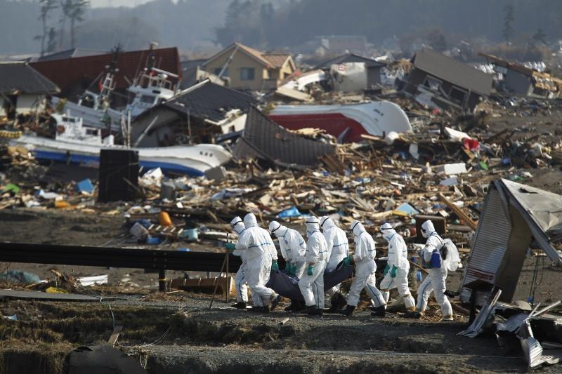 ▲311大地震及海嘯的發生,為許多日本人帶來終身難以抹滅的傷痛。(圖/美聯社/達志影像)