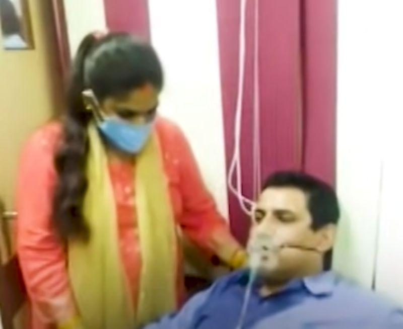 不滿請病假被拒!印度銀行員拖氧氣瓶上班 氣炸對質主管