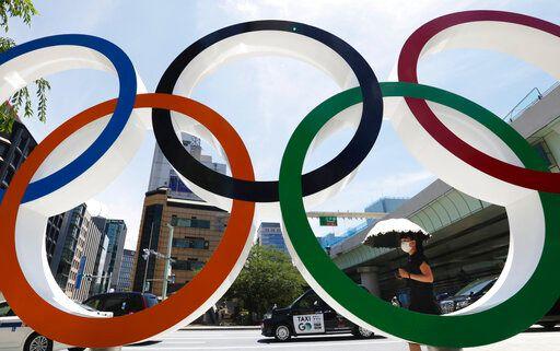 ▲東京奧運賽場上竟出現詭異人臉氣球。(圖/美聯社/達志影像)
