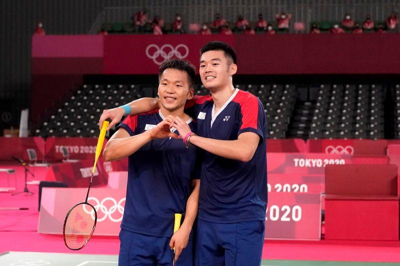 ▲我國第一男雙「麟洋配」王齊麟、李洋29日闖進四強,寫下台灣羽球男雙奧運最佳紀錄。(圖/美聯社)