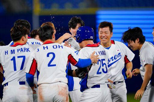▲韓國隊靠再見觸身球贏球。(圖/美聯社/達志影像)