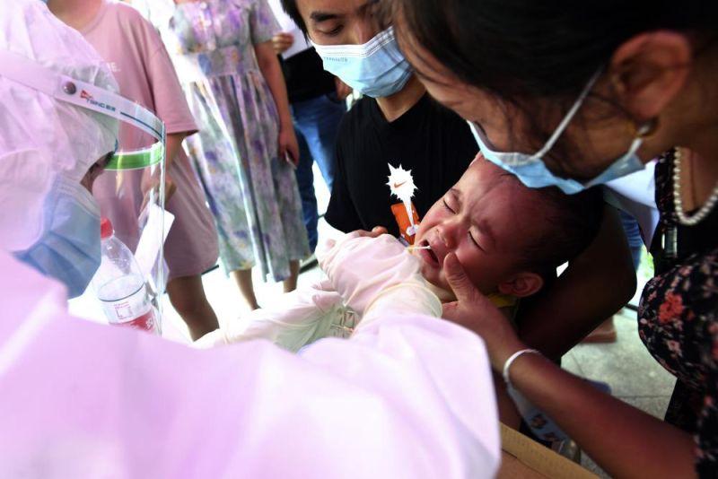 ▲武漢再度出現本土案例,當局對超過1100萬居民進行核酸檢測。(圖/美聯社/達志影像)
